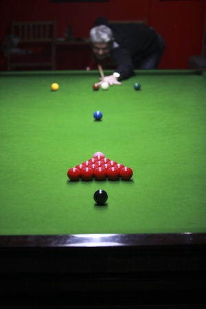 A snooker player is just about to break the balls and start a new game