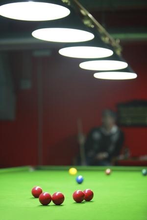 A  snooker player waiting his turn... Фото со стока