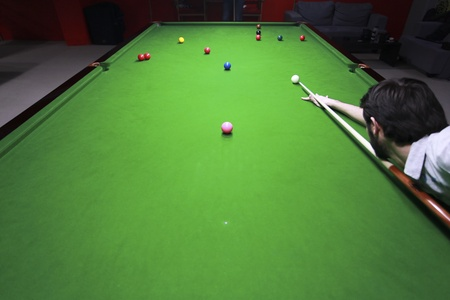 A shot from above of a snooker player