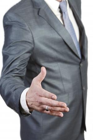 bridging the gap: Businessman oferring handshake   isolated on white background