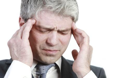 Businessman under pressure    having head ache    Фото со стока
