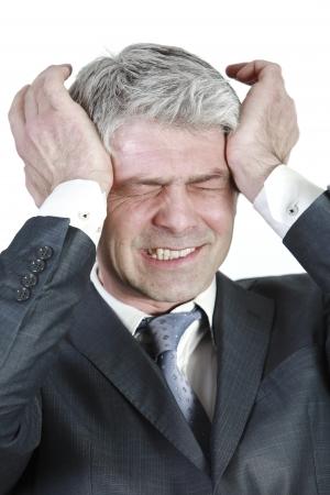 Businessman having head ache    under pressure