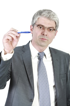 A young businessman indicating with his pen   isolated on white background