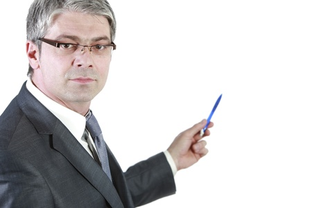 Handsome young businessman isolated on white background pointing his pen to the wall