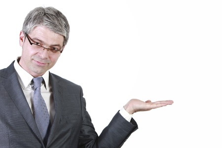 Businessman holding hand high to show something on a white board  Фото со стока