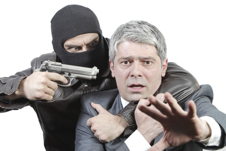 groaning: Kidnapper threating a businessman with a gun