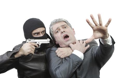 Kidnapper threating a businessman with a gun