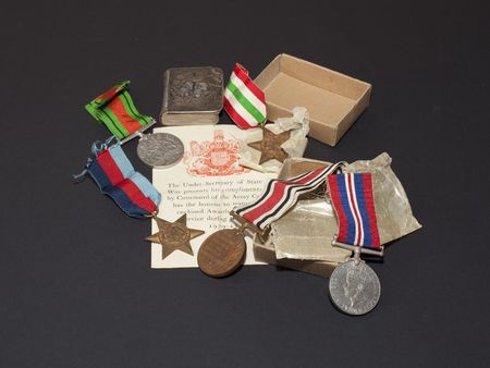 wartime: collection of wartime medals with origional boxes and award documents with a small silver bible