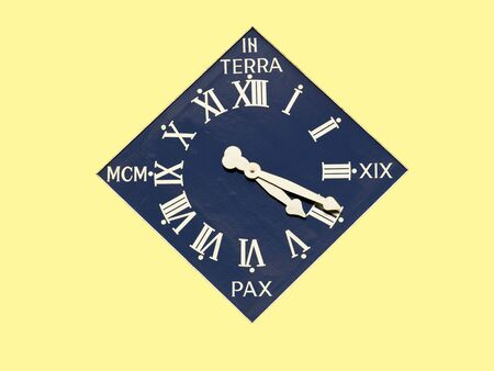 unusually: an unusually shaped gilded clock on a yellow background