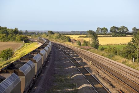 a coal train on railway tracks on a summers day photo