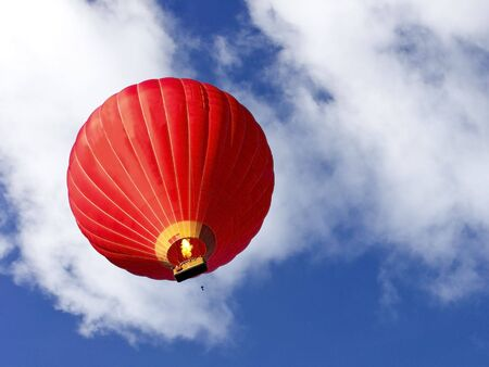 a red hot air balloon in a summer sky Stock Photo - 5523555