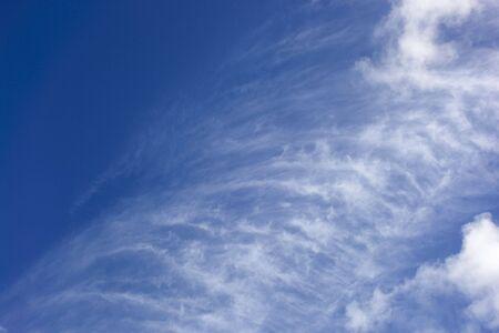 wispy: a blue sky with wispy clouds in summer