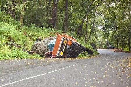 overturned: an overturned truck on the road through the mountains to vythiri in south india
