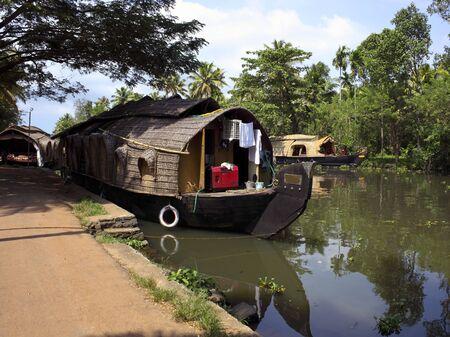 keralan houseboats at their moorings in kumarakom south india photo