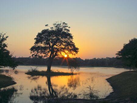 anuradhapura: an evening sky overlooking a lake in anuradhapura sri lanka Stock Photo