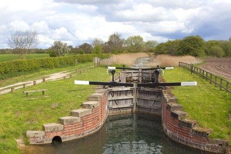 traditional wooden sluice gates controling land drainage in an english landscape in springtime Stock Photo - 6970062
