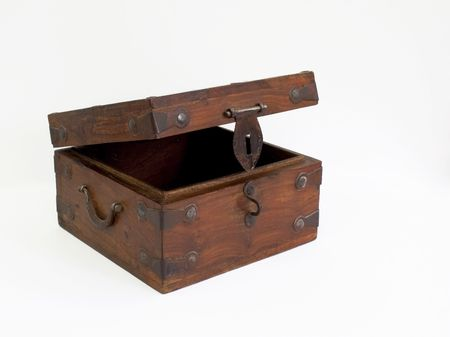 an ornamental wooden box with metal trimmings on a white background photo
