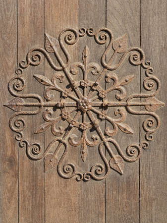 ironwork: decorative medieval ironwork mounted on an old wooden door Stock Photo