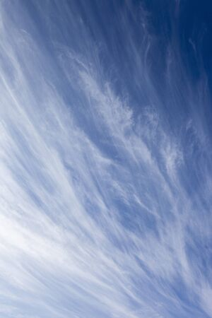 cirrus: natural background pattern and textures of a blue summer sky streaked with high cirrus clouds