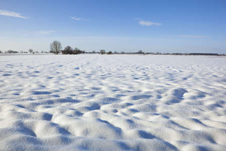 covered fields: patterns and textures of snow covered fields in a winter landscape Stock Photo