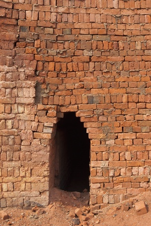 brick kiln: an arched entrance to a brickyard kiln in Mohali district of Chandigarh Punjab India