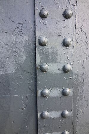 rivets: background image of a zinc painted metal surface with rivets