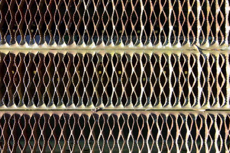 metal grate: pattern and texture of an old metal grate