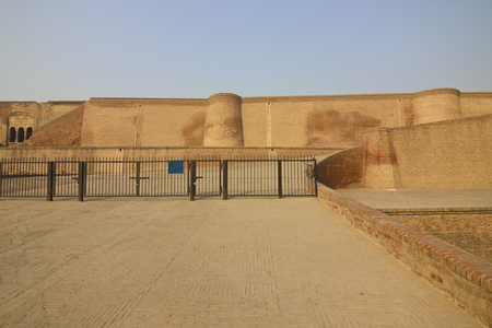 pathways: Restored red brick walls and pathways with railings at bathinda fort punjab india