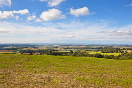 hay field: a cut hay field with views of the yorkshire wolds under a blue sky in summer Stock Photo