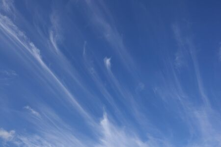 wispy: a blue summer sky background with white wispy clouds