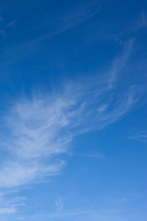 wispy: a blue sky background image with wispy clouds in summer