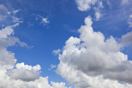clouds making: fluffy white clouds making patterns on blue sky in summer Stock Photo