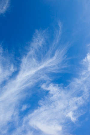 wispy: a blue sky background with white wispy cloud Stock Photo