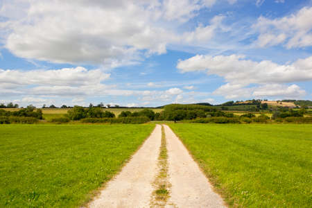 a straight limestone track with beautiful scenery in the yorkshire wolds under a blue summer sky Stock Photo