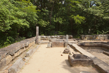 Sri lankan forest monastry ruins at ritigala in minnerya national park with trees on an archaeological site