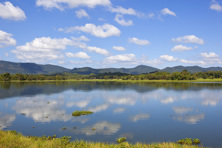 beautiful sri lanka landscape with forested mountains and sky reflected in the lake at wasgamuwa national park