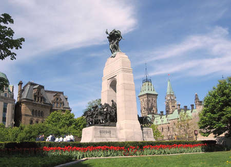 National war memorial on the background of Canadian Parliament in Ottawa,Canada