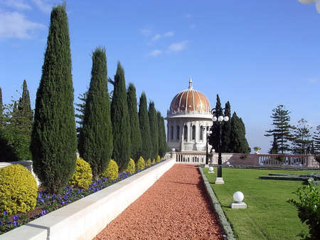 Alley of cypresses and Golden dome in Bahai Gardens in Haifa, Israel                      Stock Photo