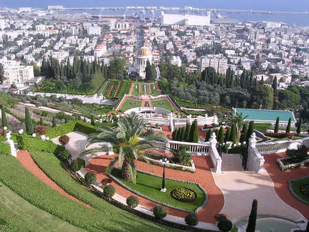 Bahai Gardens and Shrine of Bab on the background of port in Haifa, Israel