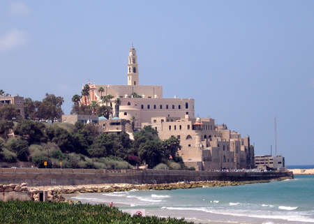 View to Al-Bahr Mosque and St Peters Church from sea in old Jaffa, Israel