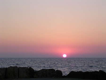 Sunset over the Mediterranean sea in Haifa, Israel                      photo