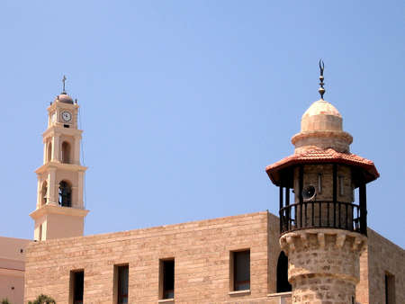 etymology: Minaret of Mahmoudiya Mosque and Belfry of Saint Peters Church in Jaffa, Israel Stock Photo