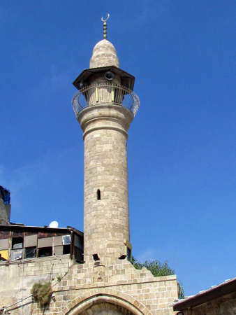 etymology: Minaret of  ancient mosque in old city Jaffa, Israel                               Stock Photo