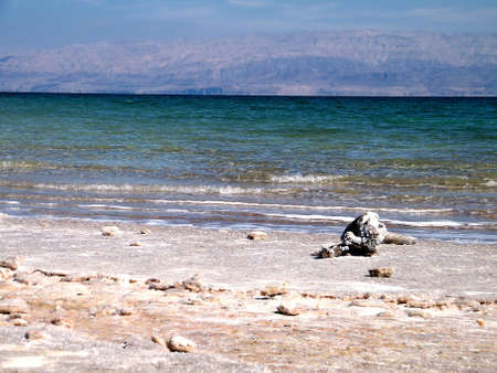 gedi: Beach of the Dead Sea and mountains in the distance in Ein Gedi, Israel