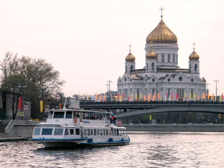 waterbus: Water-bus on Moscow river near Cathedral of Christ the Saviour at evening in Moscow, Russia