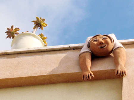 Ceramic woman on the roof of the house in quarter Neve Tsedek of Tel Aviv, Israel