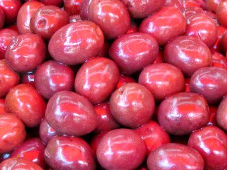 Red appetizing Olives on bazaar Carmel in Tel Aviv, Israel                               photo
