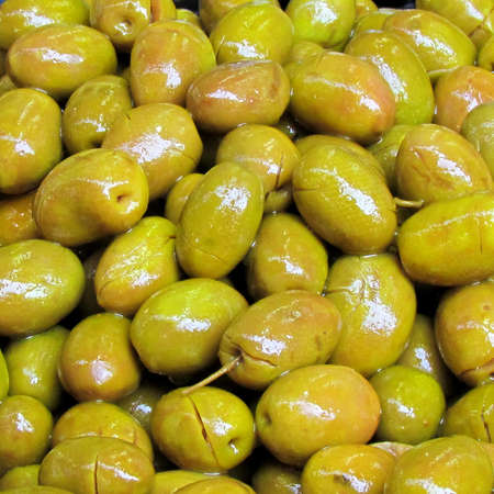 Pickled green olives on bazaar Carmel in Tel Aviv, Israel