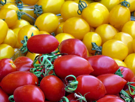 Red and yellow cherry tomatoes on bazaar in Tel Aviv, Israel                                photo