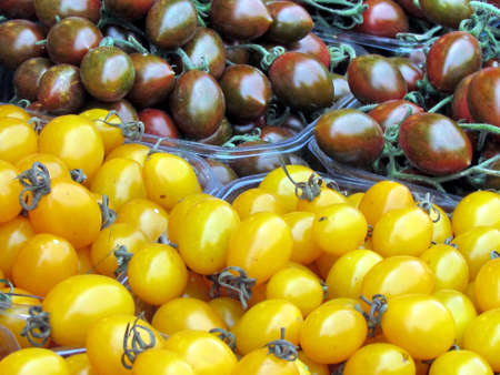 Yellow and brown cherry tomatoes on bazaar in Tel Aviv, Israel                              photo